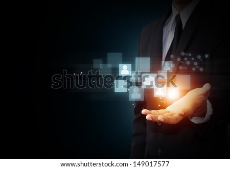 Male hand holding virtual icon of social media - stock photo