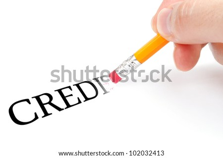 "Male hand holding wooden pencil with eraser and erase word ""credit"" - stock photo"