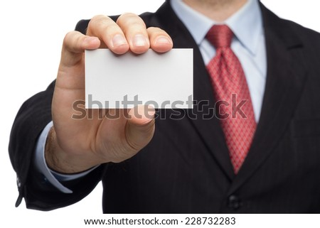 Male Hand In A Business Suit Showing Business Card - stock photo