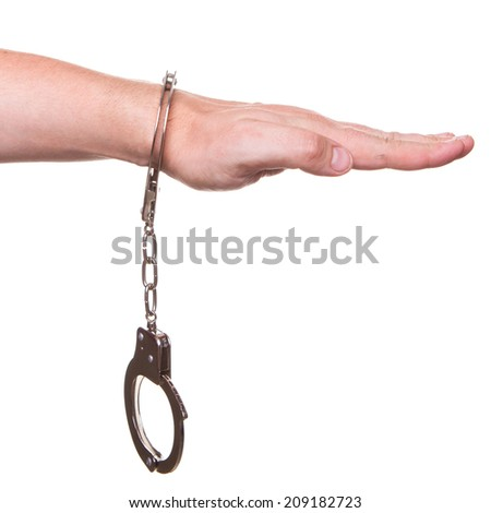 male hand in police handcuffs showing gesture isolated on white background - stock photo