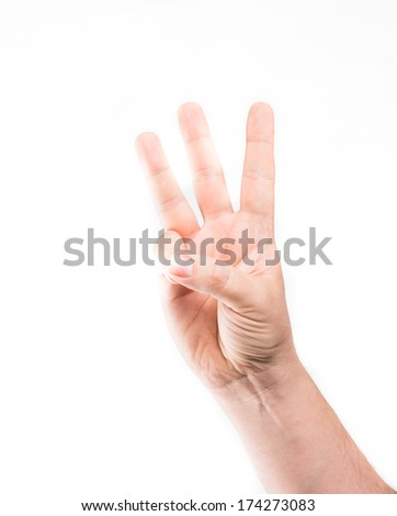Male hand is showing three fingers - stock photo
