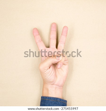 Male hand is showing three fingers. - stock photo