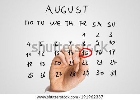 Male hand marking August 15th - Independence day in India - on a virtual calendar. - stock photo