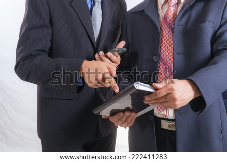 Male hand pointing at business document during discussion on white backgroud - stock photo