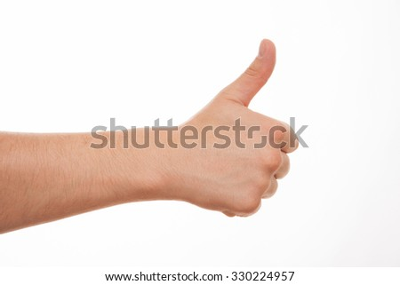 Male hand showing a thumb up sign, white background - stock photo