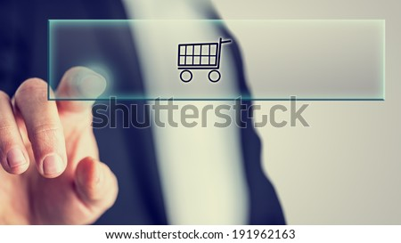 Male hand touching an online shopping button from behind. - stock photo