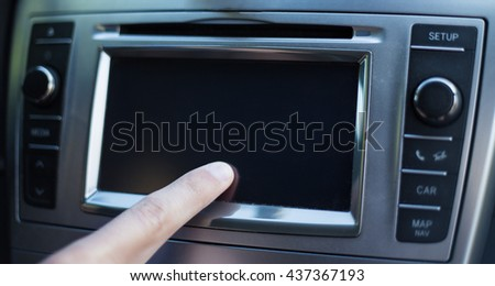 male hand touching screen in modern car - stock photo