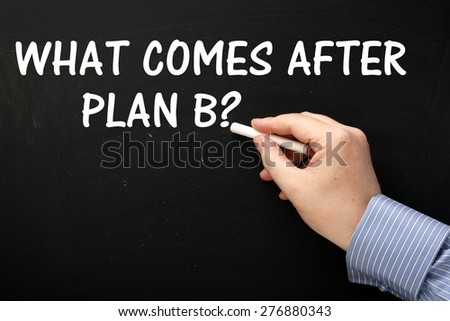Male hand wearing a business shirt writing What Comes After Plan B? in white text on a blackboard - stock photo