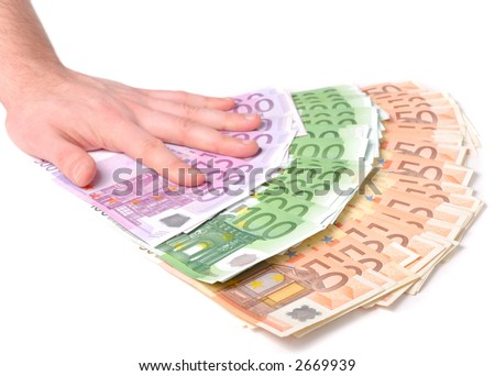Male hand with a spray of money over white background - stock photo