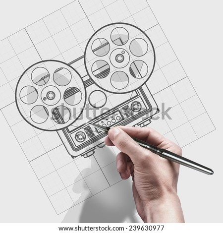 male hand with pen. engineer working on cad concept Analog recorder reel to reel. - stock photo