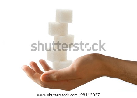 Male hand with sugar cubes - stock photo