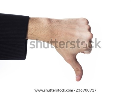 Male hand with thumbs down gesture - stock photo