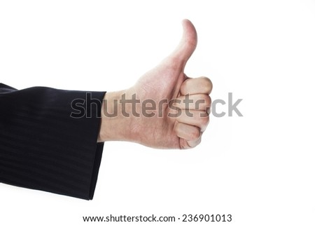Male hand with thumbs up gesture - stock photo