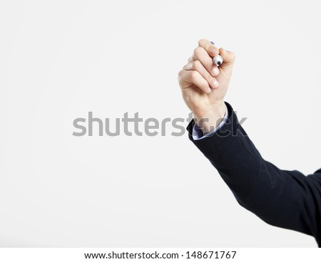 Male hand writting something on a glass writeboard - stock photo