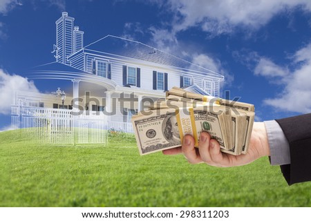 Male Handing Over Thousands of Dollars with Ghosted House Drawing, Partial Photo and Rolling Green Hills Behind. - stock photo