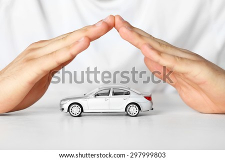 Male hands and car as protection of car concept - stock photo