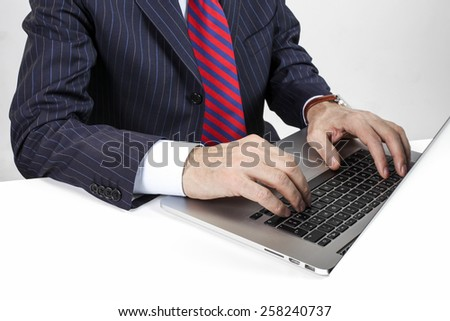 Male hands closeup typing on the laptop - stock photo