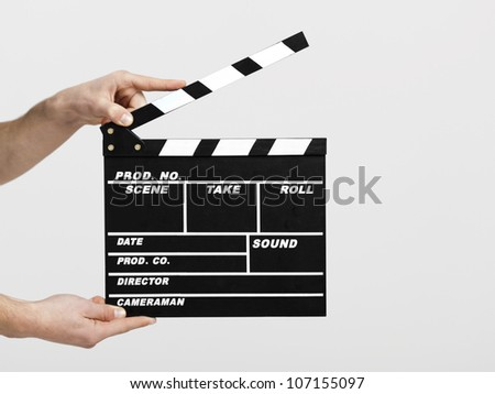 Male hands holding a clapboard, great conceptual image for ex, a new start your business - stock photo