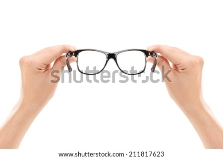 Male hands holding a pair of glasses isolated on white background - stock photo