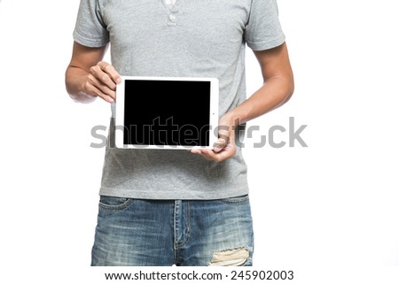 Male hands holding a tablet touch computer gadget with isolated screen - stock photo