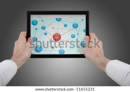 male hands holding a touchpad pc and surfing in the social network - stock photo