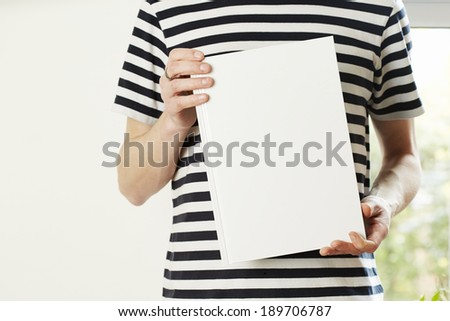 Male hands holding book with empty copy space. Student education concept - stock photo