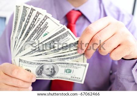 Male hands holding money us dollars. - stock photo