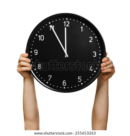 Male hands holding office clock isolated on white background - stock photo