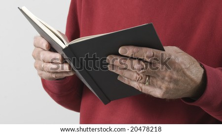 Male hands holding open book - stock photo