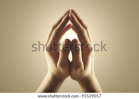 Male hands holding rays of glowing light. Magic energy in hands. Soft focus - stock photo