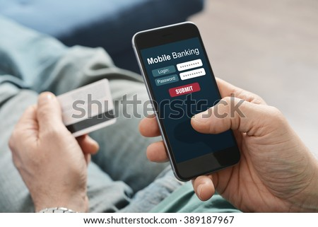 Male hands using mobile banking on smart phone - stock photo