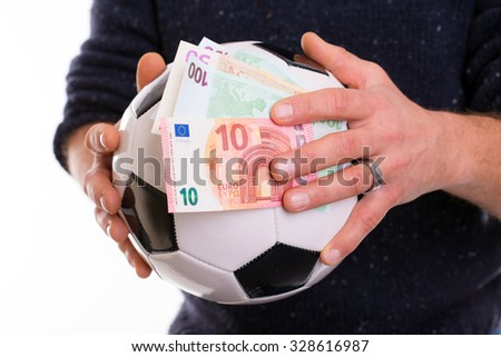 male hands with soccer- ball and money - stock photo