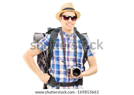 Male hiker with backpack and camera posing isolated on white background - stock photo