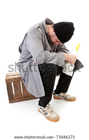 male homeless tramp with bottle over white background - stock photo