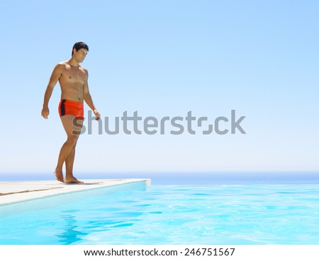 male in pool - stock photo
