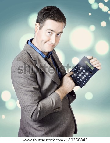 Male income tax accountant holding finance calculator when working out return on refund  - stock photo