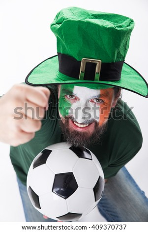 male irish soccer fan with hat looks challenging, topview - stock photo