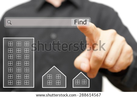 male is using on line search to find proper real estate - stock photo