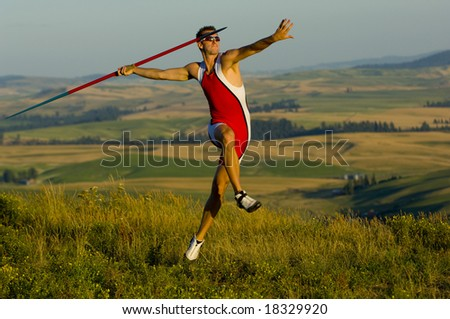 Male Javelin standing before event - stock photo
