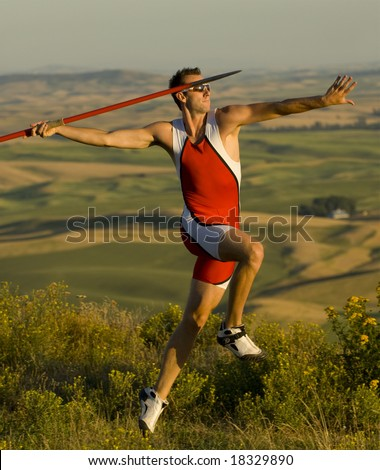 Male Javelin thrower with long view background - stock photo