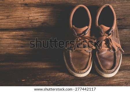male leather shoes on old wood background - stock photo