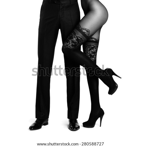 Male legs surrounded by woman. Conceptual fashion art photo isolated on white - stock photo