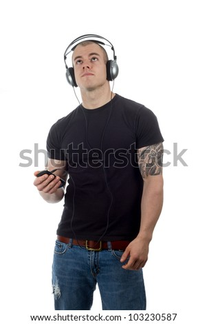 male listens to music looking up - stock photo