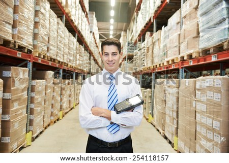 male manager man worker standing in big modern warehouse - stock photo