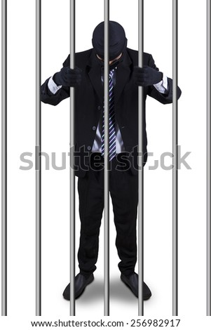 Male manager standing in the prison as the prisoner, isolated on white - stock photo