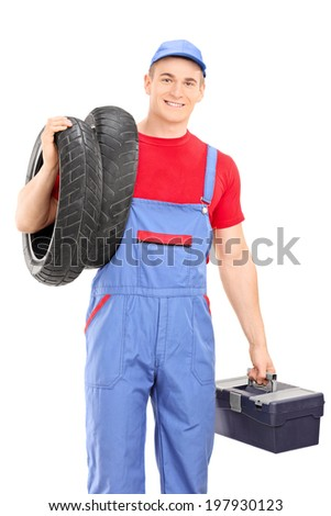 Male mechanic carrying tires and holding toolbox isolated on white background - stock photo