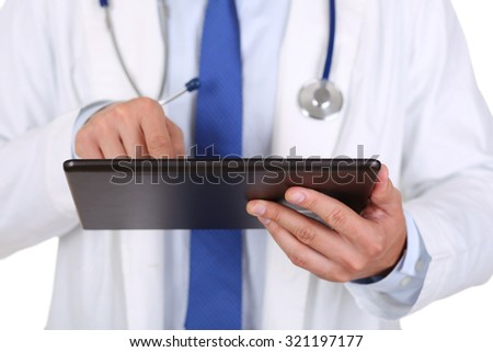 Male medicine doctor holding digital tablet pc and pointing it with finger. Medical equipment, modern technology and communication concept. Therapeutist using portable computer searching information - stock photo
