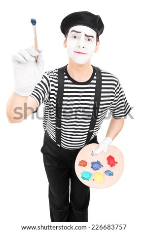 Male mime artist holding a paintbrush and a color pallet isolated on white background - stock photo