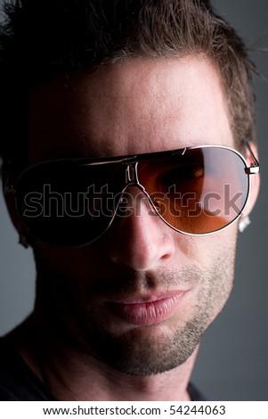 Male model Head shot with sunglasses - stock photo