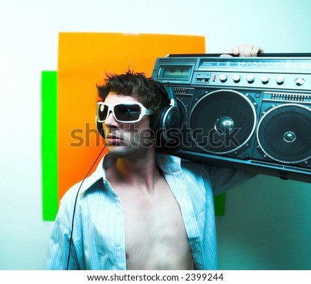 Male model holding Vintage radio - stock photo